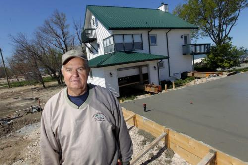 Garry Grubert at Twin Lakes Beach, Lake Manitoba flood damage area. His house is going to be slid on the new pad he poured. May 30,  2012  BORIS MINKEVICH / WINNIPEG FREE PRESS