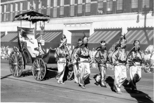 "Winnipeg Free Press Archives July 24, 1954 Red River Exhibition Scimitar-wielding ""Arabs"" cut a wide swathe down the Red River Exhibition parade route Friday night in their gay, bright-coloured garments. The ""Arabs,"" actually members of the Ancient Mystic Order of Samaritans, are pulling a carriage holding a relaxed ""sheik of the tribe."""