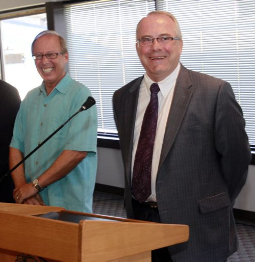 At right, Bob Downs, Development Manager with Shindico and Mayor Sam Katz at the Canad Inns Stadium site Thursday to announce the proposed sale of the Polo Park stadium site for $30.35 million to Polo Park Holdings L.P. made up of Cadillac Fairview and Shindico Realty.    Bart Kives  story  (WAYNE GLOWACKI/WINNIPEG FREE PRESS) Winnipeg Free Press  June 28 2012