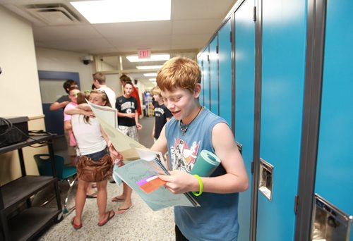 Windsor School Class of 2017 Grade seven students spend their last day of school going for ice cream to the BDI, signing year books and saying goodbye's to their grade seven   classmates that are moving on to high school and Han an exchange student who is going home after spending a year with her classmates in Canada. See Doug Speirs story. Also see more photo's taken June 20.  June 29,  2012 (Ruth Bonneville/Winnipeg Free Press)
