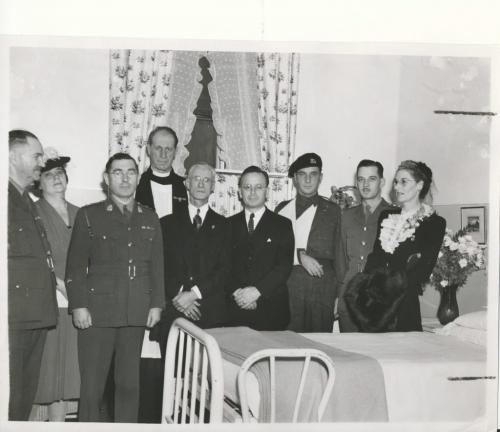 Winnipeg Free Press Archives Winnipeg WWII Home Front November 23, 1944 A number of the officials taking part in the ceremony Wednesday at the Children's hospital when the officers and men of the 18th Armored Car regiment (12th Manitoba Dragoons), endowed a -ward to the Winnipeg Children's hospital, are , shown in the above photograph. From leit to I right, they are,. Ll-CoL P.- H. Couplarid, former. commanding officer of 12th Manitoba Dragoons, now stationed at Shilo; Mrs. W. P Fillmore, president of the board of the Children's hospital: Canon William Askey, Dr. G. Williams, Premier Stuart Garson. Cpl. A. Everett, who made the presentation of the $1,000 bond; Capt. H. J. Giroux, and Mrs. Homer Robinson.'