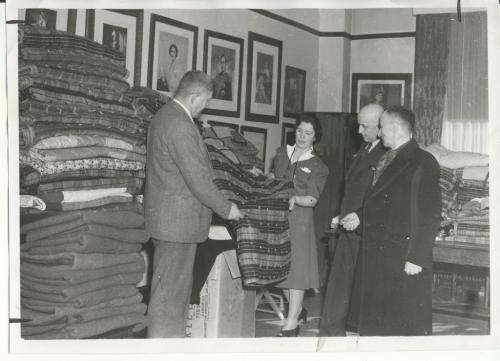 Winnipeg Free Press Archives Winnipeg WWII Home Front March 6, 1943 Winnipeg Polish Relief officials inspected the splendid collection of blankets, clothing and relief supplies now ready for shipment overseas. The supplies were purchased by the I.O.D.E., with money raised by Winnipeg's-Polish societies. The Free Press cameraman snapped representatives at the I.O.D.E. headquarters. <>05 Union Trust building Thursday. They include, left to right. J. H. Wach, president of the Holy Ghost Fraternal  Aid society; Mrs. A. .7. Richardson. Provincjal war Convener, I.O.D.E.; J. Chmeilewski. recording secretary, Polish National Relief committee and B. Zeglinski, president, Polish National Relief committee.