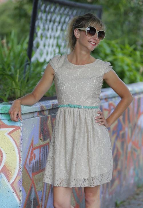 SUMMER KEEPING COOL FASHION. Lace low back cocktail dress with turcoise belt and sunglasses paper fan. July 9, 2012  BORIS MINKEVICH / WINNIPEG FREE PRESS