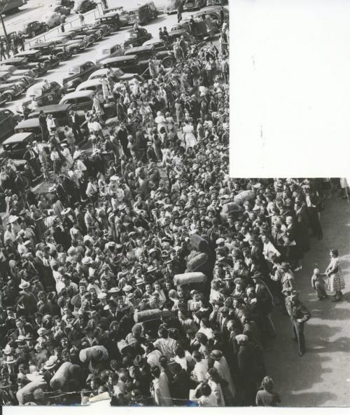Winnipeg Free Press Archives Winnipeg WWII Home Front July 28, 1945  The line of soldiers, with duffle bags, can be seen passing through the crowd, at the CN Station. Many families in the city will spend their happiest week-end for five years.