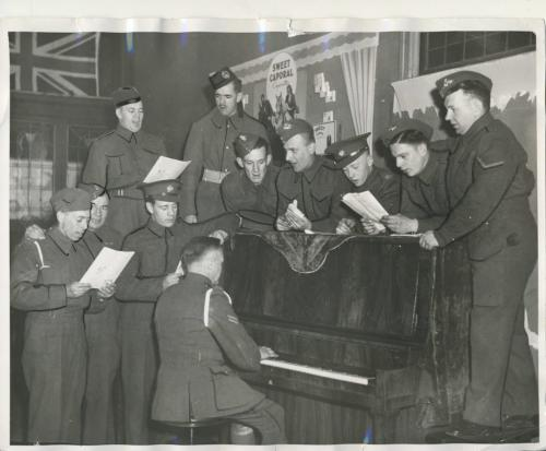 Winnipeg Free Press Archives Winnipeg WWII Home Front April 6, 1940 All happy and gay Soldiers stationed in the Winnipeg district will not lack recreation. Here is the Knights of Columbus army hut, opened informally on Main street and Graham Avenue Friday. Among the first to use the spacious new premises are the group shown above, trying out the piano.