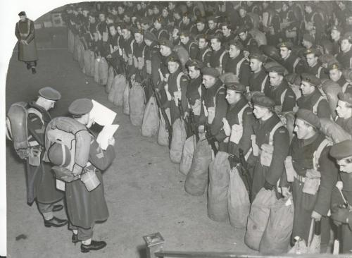 Winnipeg Free Press Archives Winnipeg WWII Home Front February 14, 1945 These pictures, just released by the Canadian army, show soldiers of a Manitoba unit, which contains a proportion of N.R.M.A. personnel, reporting back for duty at Fort Osborne barracks prior to leaving at the end of December for eastern Canada. They are now serving overseas as reinforcements. A number of men of the same unit failed to report back after leave and are now the object of a wide-spread man-hunt by military and civil police. Left, members of the unit answer to their names in the Fort Osborne garrison drill hall, after returning 'on schedule.