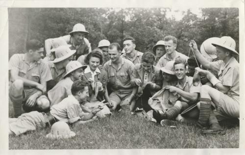 Winnipeg Free Press Archives Winnipeg WWII Home Front July 16, 1942 A happy sewing circle in Assiniboine park. Thursday morning, when girls of Winnipeg company of the Canadian Women's Army Corps gave a darning lesson 'to soldiers of the 3rd Field Ambulance, R.C.A.M.C. They showed the soldiers just how to darn their own socks and repair their shirts. The instructors in this group are Private Alice Pelcher, Brandon, and Audrey Badgley, Woodmore, Man., while the soldiers include Privates Walter Pawlowicz, Toronto; Arthur Tiessen, Leamington, Ont.; M Snirer and Omer Roy, both o£ Montreal.