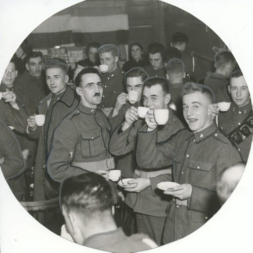 "Winnipeg Free Press Archives Winnipeg WWII Home Front November 4, 1939 The Salvation Army hut opened in the Forum building, Main street, Friday night. A Free Press photographer was on hand and caught some scenes of the event. At the top, left, two soldiers, with steaming hot cups oi coffee, enjoy a game of checkers. Three nurses from Grace hospital, who helped in serving refreshments, are shown at top, right. They are, reading from left to right; Capt. H. Milley, . Capt. L. Hall and Capt. E. Patterson. The picture at lower left shows . a general view of the soldiers enjoying refreshments. At lower right, Brigadier B. W. Browne, officer commanding M.D. 10, is giving an "" address at the opening ceremonies. On the platform, reading from left to right, are Major J. L. R. Sutcliffe, Lieut-Col. R. T. Spooner, Brigadier- General Browne, Alderman C. E. Simonite and Captain William Carroll"