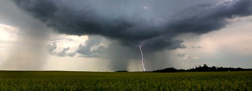 Brandon Sun Lightning strikes the ground through the clouds of a passing storm front that swept across the prairies west of Brandon, Man., on Thursday afternoon July 12 2012. (Bruce Bumstead/Brandon Sun)