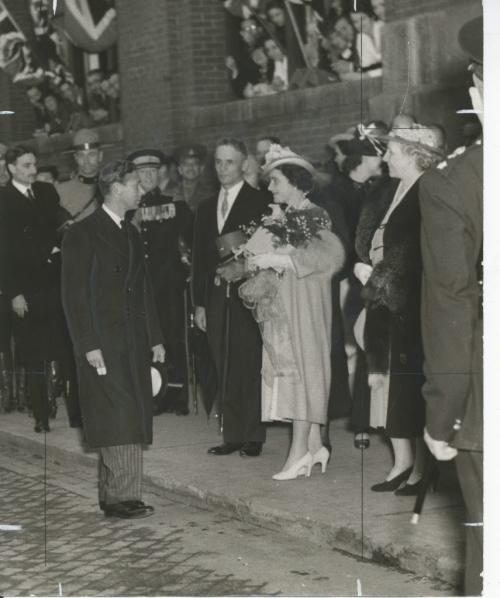 Winnipeg Free Press Archives . .Their Majesties King George VI and Queen Elizabeth are seen above as they bade farewell to Premier John Bracken at the. Canadian Pacific station, Wednesday night. His Majesty has just rejoined the Queen, after inspecting; the guard of -honor provided by the naval-and air force units, This was the last picture  of Their Majesties to be taken in Winnipeg, and was  snapped by Augie May, Free Press .staff photographer. May 25 1939. fparchive