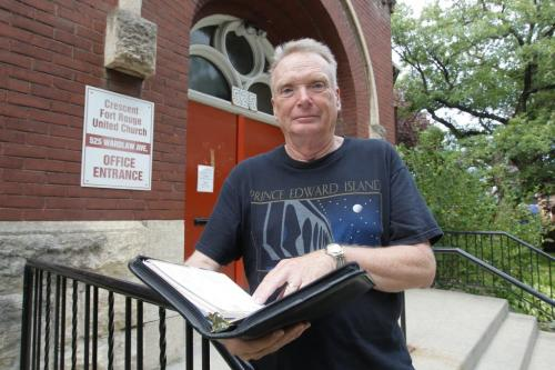 Retired minister Ken Anstie poses for a photo at Crescent Fort Rouge United Church. Refugee housing story.  July 19, 2012  BORIS MINKEVICH / WINNIPEG FREE PRESS