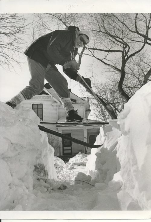 Gerry Cairns/ Winnipeg Free Press Archives Winnipeg Blizzard (2) March 5, 1966 Skier on Snow Banks- Furby Street, after snow storm fparchive
