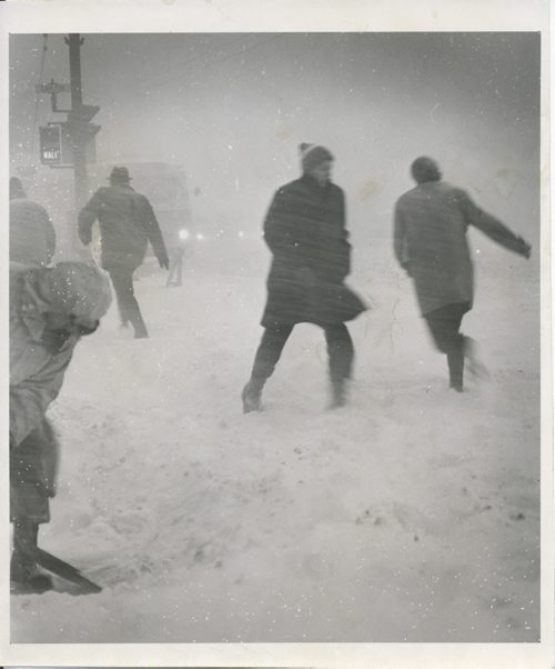Winnipeg Free Press Archives Winnipeg Blizzard (20) March 4, 1966 Determined citizens Friday struggled   to work in spite of blinding blizzard conditions. Here a few are shown fighting their way across a downtown Intersection. fparchive