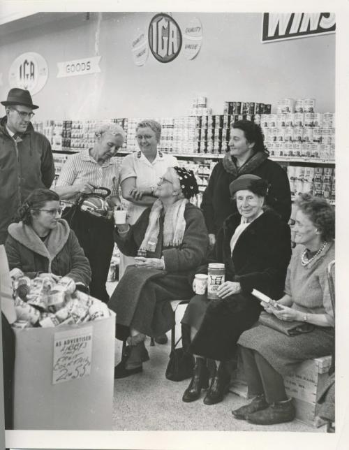 Winnipeg Free Press Archives Winnipeg Blizzard (37) March 24, 1964 Blizzard Paralyzes Province Here is a group of the people stranded at the IGA store Monday night. They arc from left to right, seated, Mrs, Carl Marceniuk, 399 Harbison Ave.; Mrs. A. Wells, Kiwanis Court, St. James; Mrs. A. Askew, Kiwanis Court, St. James; Mrs. Ruth Stoesz, 1156 Penninghamc Ave., Garden City. Those standing are store manager, Orest Luhowy; Brig. Winnifred Fitch, Sunset Lodge; Miss Delene Anderson, Sunset Lodge; Mr. R. Holm, 423 Aldine St., St. James. fparchive