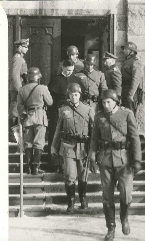 Winnipeg Free Press Archives If Day - World War II - (16)  Feb. 19, 1942 Nazi Storm Troopers Demonstrate Invasion Tactics Nazis escort Rev. John Anderson from All Saints Church. fparchive
