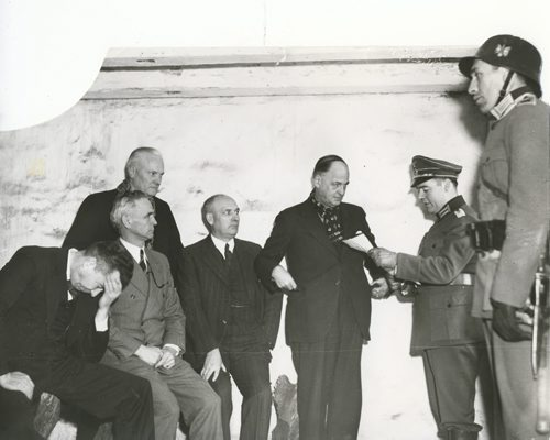 Winnipeg Free Press Archives If Day - World War II - (20) Feb. 19, 1942 Nazi Storm Troopers Demonstrate Invasion Tactics Nazi officers read charges to civic and provincial dignitaries after confining them to the dungeon. Left to right, Hon. Errick Willis, Premier John Bracken., Hon. J. S. McDiarmid, Hon. James McLeneghan and Mayor John Queen. fparchive