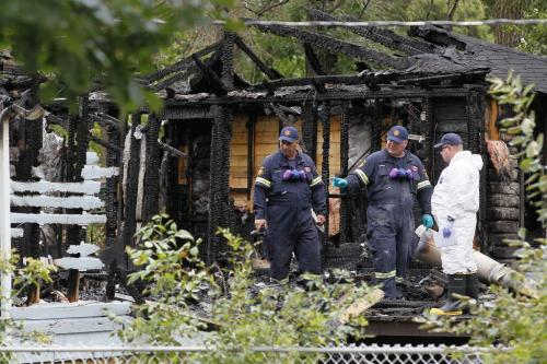 August 5, 2012 - 120805  -  Investigators inspect the charred shell of a Prospect Street home in Winnipeg Beach where two people died and one was sent to a Winnipeg hospital early Sunday morning August 5, 2012.    John Woods / Winnipeg Free Press