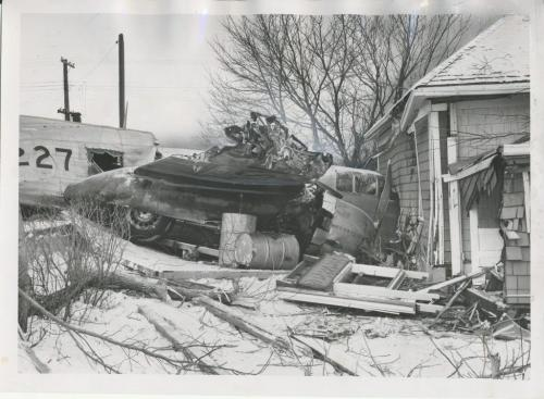 Winnipeg Free Press Archives St. James-air-crash Feb. 18 1957 A path of destruction through residential St. James ended here Sunday night as an RCAF Mitchell Bomber came to rest with its nose pushed into the living room of Clarence Campbell's home, 435 Ferry Rd. The Campbells were out when the plane hit.