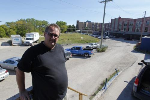 Wayne Kitchur poses for a photo with City property behind him. Mulvey Ave East near Osborne. August 30, 2012  BORIS MINKEVICH / WINNIPEG FREE PRESS