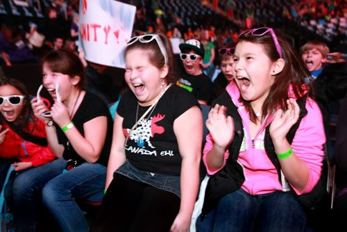 Grade 5 students from Beausejour Early Years cheer during We Day 2012 as it  got underway at the MTS Centre Tuesday morning. The annual We Day celebrations  in Winnipeg today with several iconic social activists and entertainers taking the stage at MTS Centre infront of 18,000 kids from around 400 schools from all over Manitoba. Marc Kielburger and his brother Craig  talk to the crowd at MTS Centre. Marc and Craig are internationally acclaimed children's rights activists and co-founders of Free The Children. 121030 - Tuesday, October 30, 2012 - (RUTH BONNEVILLE / WINNIPEG FREE PRESS)   Ruth Bonneville