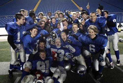 The Oak Park Raiders celebrate after winning the championship game 30-15. The Oak Park Raiders and Vincent Massey Trojans played in the Home Run Sports Bowl at Canad Inns Stadium Thursday evening. The Raiders won the game 30-15. 121108 - Thursday, November 08, 2012 -  (MIKE DEAL / WINNIPEG FREE PRESS)