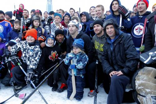 Mike Richards and Andrew Ladd had a street hockey game on the top level of the Forks parkade today at 4 p.m.  Here they pose for a photo with the group after the game. November 13, 2012  BORIS MINKEVICH / WINNIPEG FREE PRESS