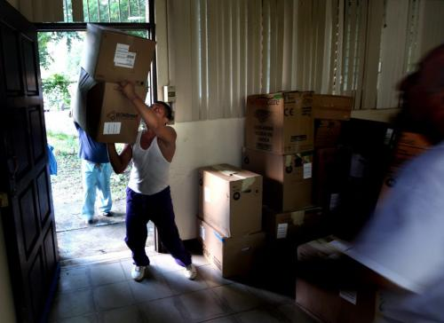 A delivery man juggles a stack of boxes as the Op-Walk's medical supplies arrive at the hospital in Managua. Phil Hossack / Winnipeg Free Press October 25, 2012