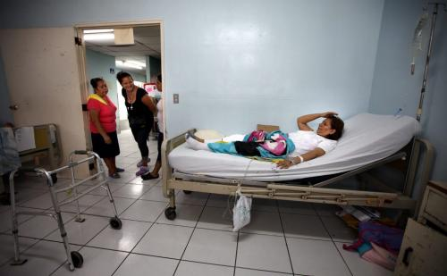 Sylvia Vega is greeted by smiling visitors as she arrives on the ward after surgery in Managua. Phil Hossack / Winnipeg Free Press October 25, 2012