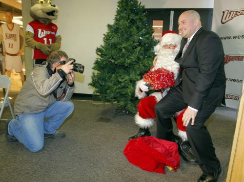 46th Wesmen Classic press conference. Wesmen men's basketball coach Mike Raimbault gets photographed with Santa during the event. December 3, 2012  BORIS MINKEVICH / WINNIPEG FREE PRESS