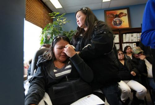 Corina Okemow (crying, left) is consoled by a friend of the family Celine Samuel after she breaks down into tears while hearing her younger brother's testimony (Ralph Okemow) during a press conference Thursday afternoon.  The press conference was held to bring attention to the death of their younger sister Tracy Okemow while she was in  RCMP custody on Nov 30th on God's Lake Reserve. See Alex Paul story. Dec 13, 2012, Ruth Bonneville  (Ruth Bonneville /  Winnipeg Free Press)