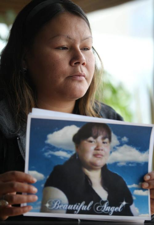 Corina Okemow holds a picture of her younger sister Tracy after a press conference Thursday afternoon.  The press conference was held to bring attention to the death of their younger sister Tracy Okemow while she was in  RCMP custody on Nov 30th on God's Lake Reserve. See Alex Paul story. Dec 13, 2012, Ruth Bonneville  (Ruth Bonneville /  Winnipeg Free Press)