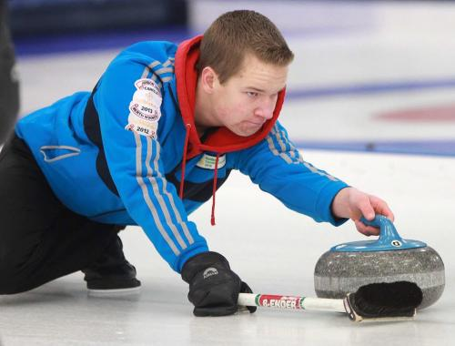 Cole Peters from West St Paul Curling Club competes against Matt Dunstone in the  Tim Hortons Christmas Youth Bonspiel at Deer Lodge Curling Club Friday night- See Ed Tait story- December 27, 2012   (JOE BRYKSA / WINNIPEG FREE PRESS)