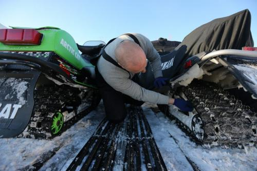 Kevin Slezak secures his snowmobiles to a trailer at the 59er on Highway 59, after riding with his wife Michelle, Saturday, December 29, 2012. (TREVOR HAGAN/WINNIPEG FREE PRESS)
