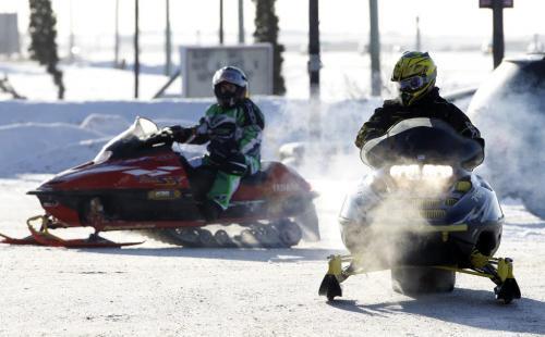 Snowmobilers pull in to the 59er on Highway 59, Saturday, December 29, 2012. (TREVOR HAGAN/WINNIPEG FREE PRESS)