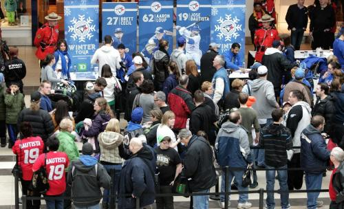 Hundreds of fans wait in line to get autographs from Toronto Blue Jays who are in town while on a cross country fan appreciation tour. Organizers of the event are unofficially saying around 2500 fans showed up to get a chance to meet Jays' Brett Cecil, Aaron Loup and Jose Bautista at Polo Park Shopping Centre.  130106 January 6, 2013 Mike Deal / Winnipeg Free Press
