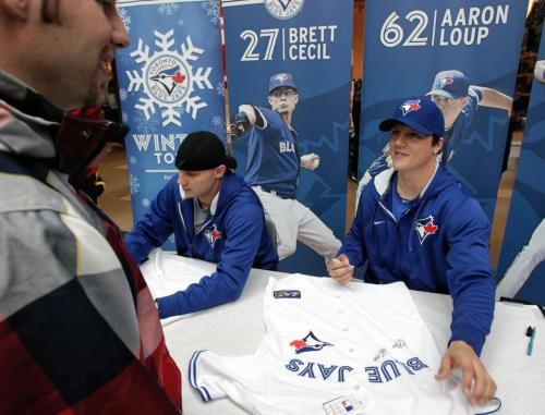 Fans in line to get autographs from Toronto Blue Jays Brett Cecil and Aaron Loup who are in town while on a cross country fan appreciation tour. Organizers of the event are unofficially saying around 2500 fans showed up to get a chance to meet Jays' Brett Cecil (left), Aaron Loup (right) and Jose Bautista at Polo Park Shopping Centre.  130106 January 6, 2013 Mike Deal / Winnipeg Free Press