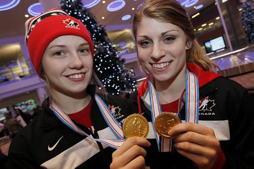 January 6, 2013 - 130106  -  Ashleigh Brykaliuk (L) and Cassidy Carels show off their 2013 IIHF Ice Hockey U18 Women's World Championship medals after returning from Finland Sunday January 6, 2013 at James Richardson Winnipeg International Airport.  John Woods / Winnipeg Free Press