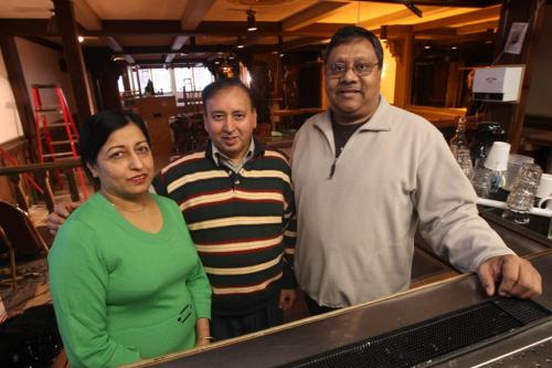 Downtowner Motor Hotel to see new life- Owners of the India Palace Ashwani Nagpal, centre and his wife Suroj, left, and Manny Singh from Sovereign Construction Ltd inside the cocktail lounge that is under construction  in The Downtowner Motor Hotel . It will see new life as a student housing building. - See Murray McNeill story– January 11, 2013   (JOE BRYKSA / WINNIPEG FREE PRESS)