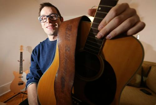 Matt Weinstein holds an acoustic guitar he found that belonged to Bill Edmondson who played with Neil Young in The Squires, Saturday, January 12, 2013. (TREVOR HAGAN/WINNIPEG FREE PRESS)