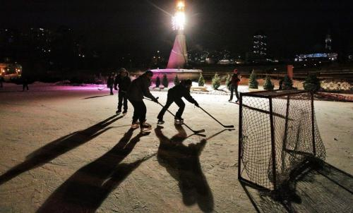 Teenagers play a game of pick-up hockey on the Assiniboine River at The Forks Wednesday evening as the temperature hit -23C.  130116 January 16, 2013 Mike Deal / Winnipeg Free Press