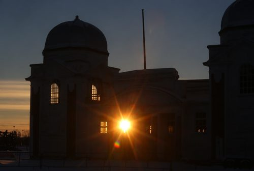Brandon Sun The setting sun shines through the windows of the Provincial Exhibition Dome Building on the grounds of the Keystone Centre on Saturday evening. (Bruce Bumstead/Brandon Sun)