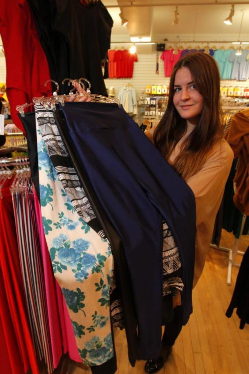 American Apparel worker Kirsty Lesperance in photo with some leggings they sell. The fashion giant is located in Osborne Village. January 30, 2013  BORIS MINKEVICH / WINNIPEG FREE PRESS