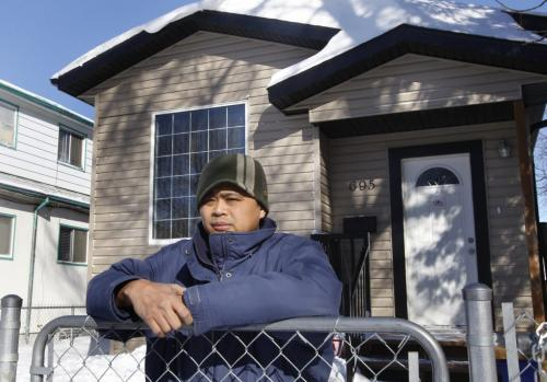 Arnel Mercado lives in a Pritchard Avenue home (695 Pritchard) that was built with falsified engineering seals, which the city is now investigating. Mercado said the city did not discover the problem until he applied for a permit to renovate his basement in November.  Jen Skerritt  story  (WAYNE GLOWACKI/WINNIPEG FREE PRESS) Feb. 19 2013