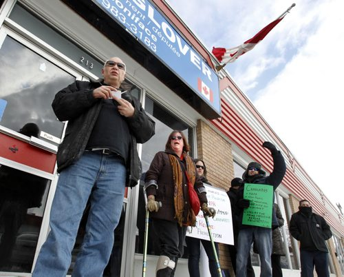 At left, Bill VanderGraaf, retired Winnipeg Police Staff Sergeant was one of the dozen protestors outside MP Shelly Glover's office on St. Mary's Road Thursday against the Federal¤Governments proposed changes to the Medical Marihuana Access Regulations. Oliver Sachgau story (WAYNE GLOWACKI/WINNIPEG FREE PRESS) Feb. 21 2013