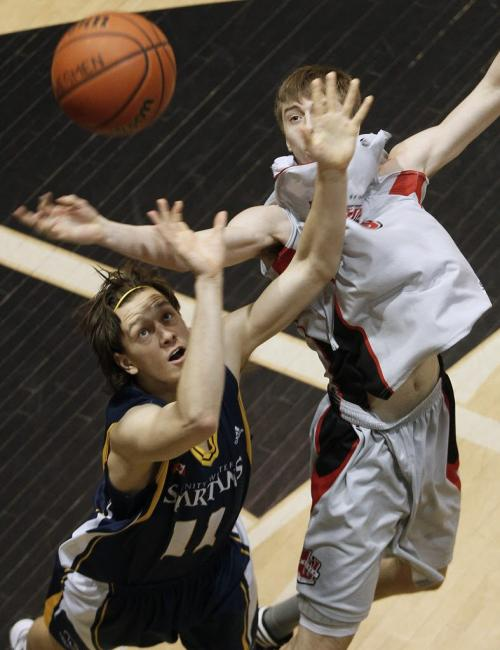 February 24, 2013 - 130224  - University of Winnipeg Wesmen Kristjan Lamont (9) and Trinity Western University Spartan Taylor Heinrichs (11) fight for the rebound in the Canada West Basketball finals at the University of Winnipeg Sunday February 24, 2013.  John Woods / Winnipeg Free Press