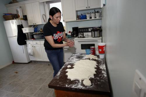 Althea Guiboche  makes Bannock in her home  and hands it to  people on the street – geoff kirbyson story  KEN GIGLIOTTI / Mar. 12 2013 / WINNIPEG FREE PRESS