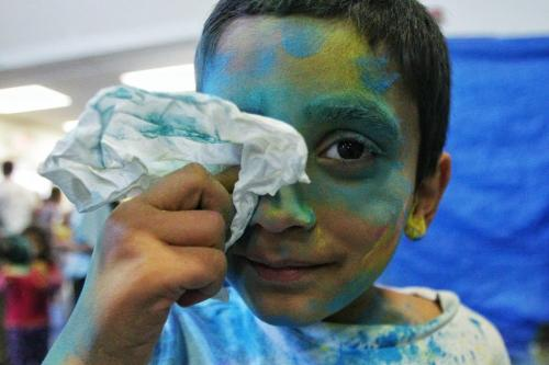 Dev Patel, 5, wipes his face after getting an eyeful of coloured powder while observing Holi, a religious spring festival celebrated by Hindus as a festival of colours at the Dr. Raj Pandey Hindu Centre Sunday afternoon.  130331 March 31, 2013 Mike Deal / Winnipeg Free Press