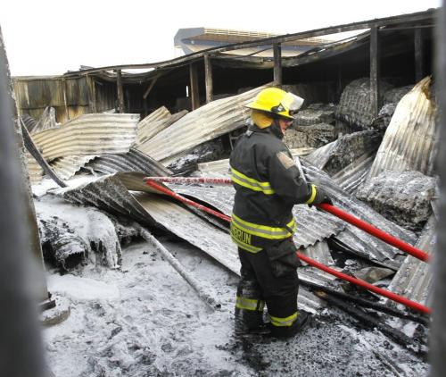 Winnipeg Fire Fighters had to return to the shed at the Canad Inns Stadium that caught fire Tuesday night to hose down some hot spots Wednesday morning. Wayne Glowacki Winnipeg Free Press April 3 2013