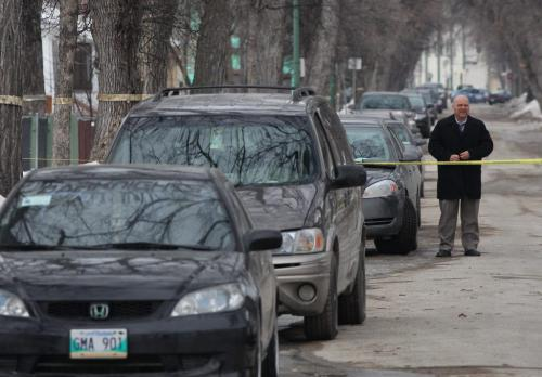 Winnipeg Police identification officers gather evidence from Tuesday afternoon homicide scene in the 500 block of Langside St Wednesday afternoon –Detective arrives on scene to continue  door to door interviews-standup photo- April 03, 2013   (JOE BRYKSA / WINNIPEG FREE PRESS)