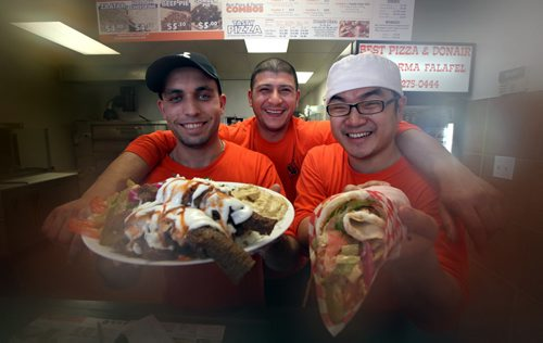 """Left to right, Loai Assaf, Taz Adel and Yenu Li will be happy to serve up a  donair platter and a chicken shawarma (right) at the """"Best Pizza and Donair"""" See Marion's review. April 9, 2013 - (Phil Hossack / Winnipeg Free Press)"""